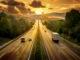 Autobahn mit LKW bei Sonnenuntergang